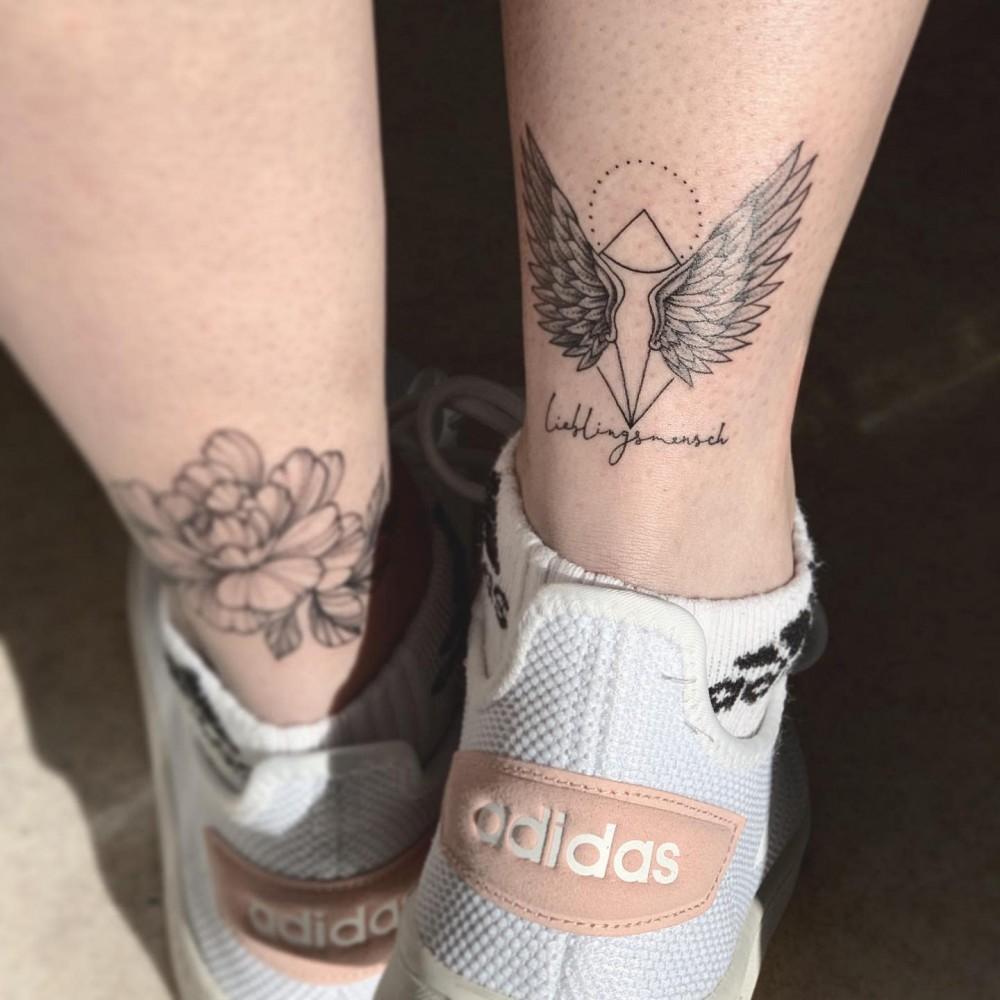 black-grey-angel-wing-tattoo-miarttattoo