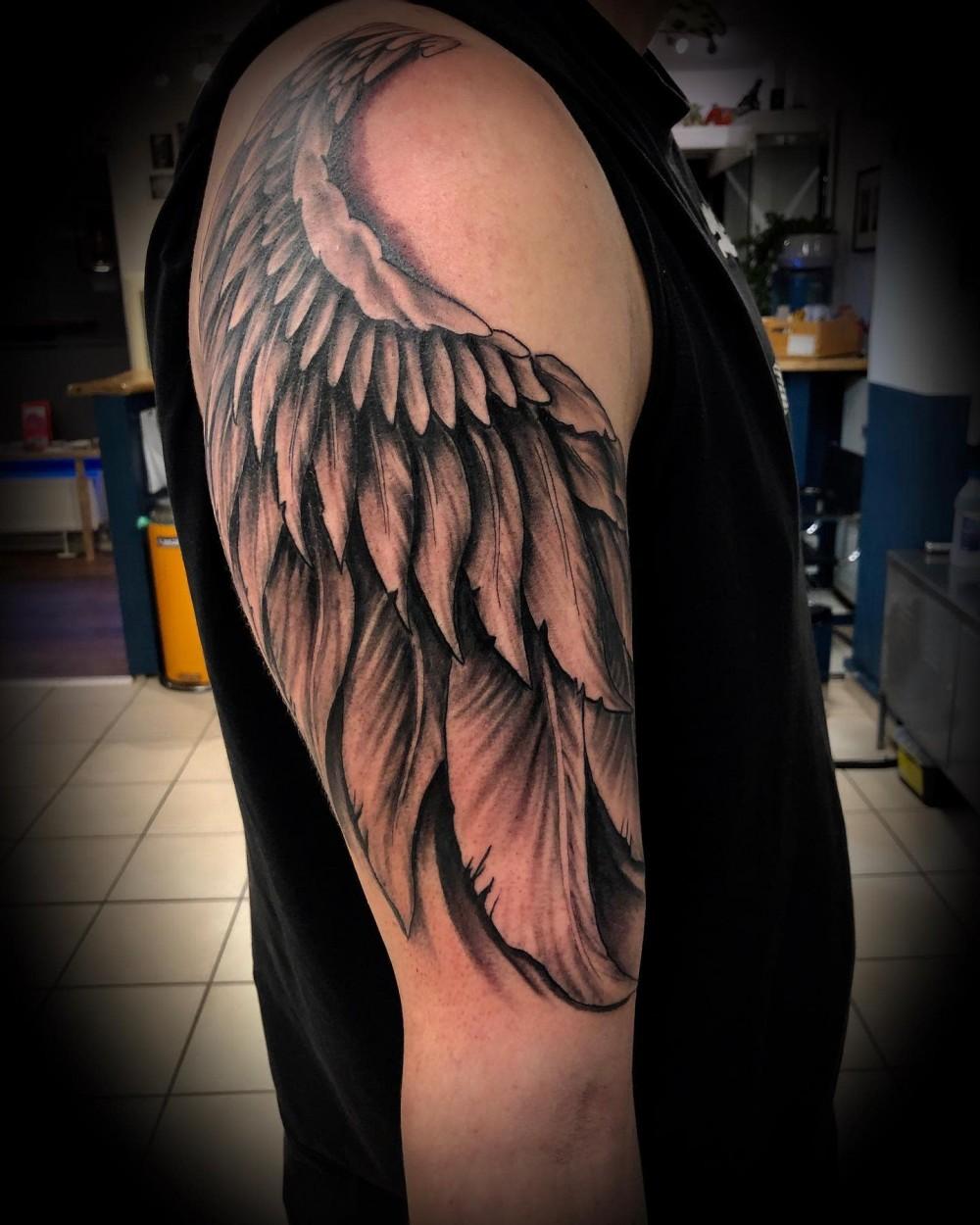 black-grey-inked-realism-angel-wing-tattoo-nedelincvetanov