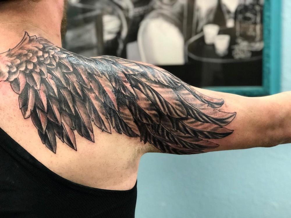 worm-angel-wing-tattoo-brickhouse_tattoos