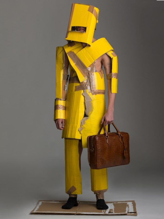 men wearing yellow paper cloth with bag