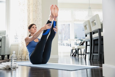 Image may contain Fitness Exercise Human Sport Sports Working Out Person Yoga Furniture and Chair