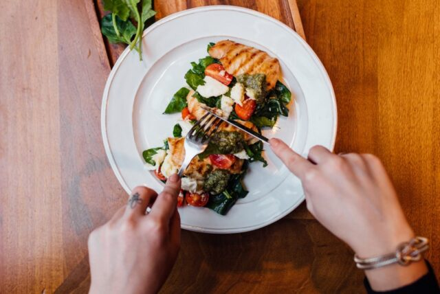 Image may contain Food Meal Dish Human Person Plant Seasoning and Culinary