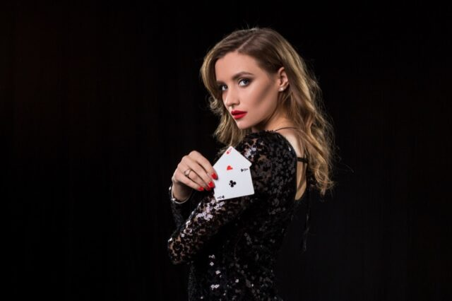 Woman Holding Cards Black Sequin Dress