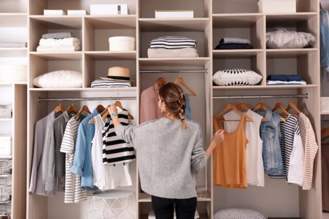 Woman Organizing Closet Clothes Wardrobe