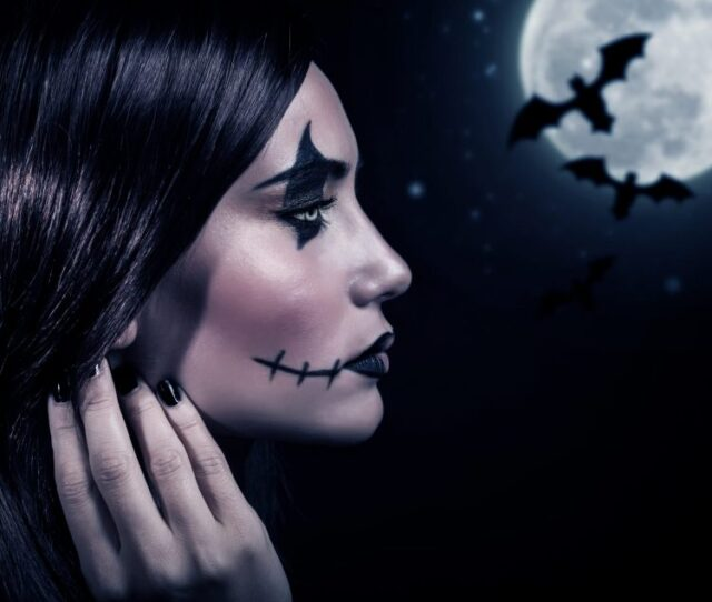 Side view of terrifying witch in Halloween night, bats on full moon background, portrait of werewolf on scary dark night, horror concept