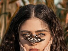 beautiful woman with butterfly on her nose