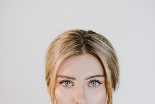 content gentle woman with blue eyes