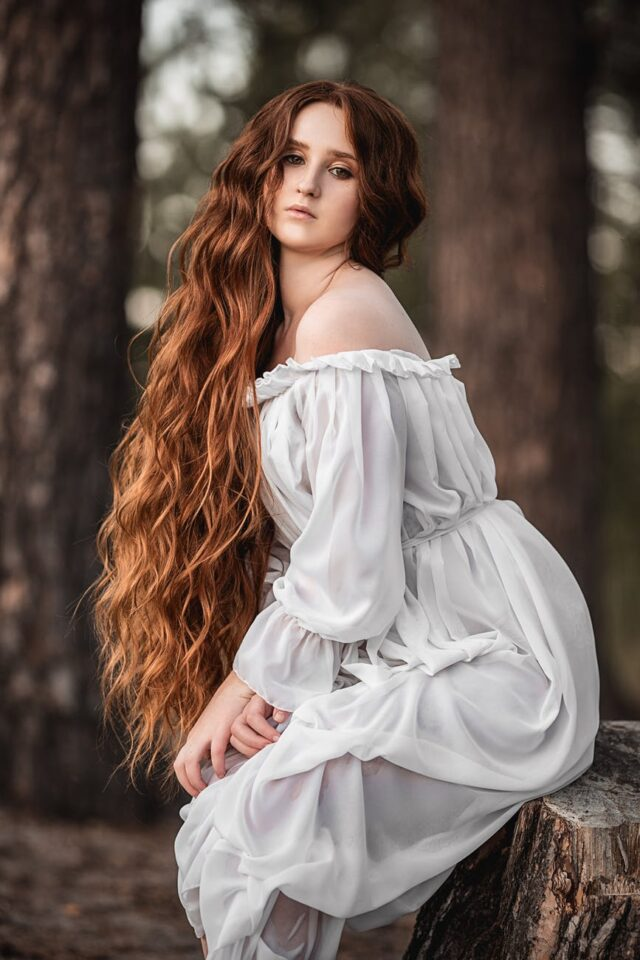 woman in light white dress in forest