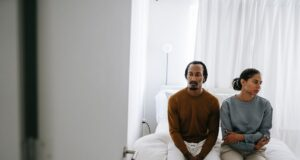 black couple spending time on bed at home