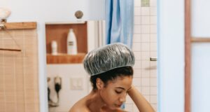 woman filling bath with water for cleaning procedure